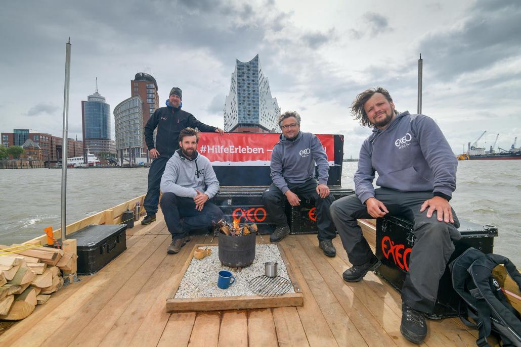 """Die drei EXEO-Gründer und ihr Kapitän: Theis Hanck, """"Käpt'n Bappe""""/ Bappe Bockelmann, Sönke Petersson, Michael Harren (v. li.)"""